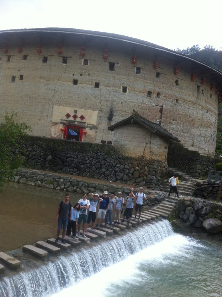 In front of a 650 year old Tulou